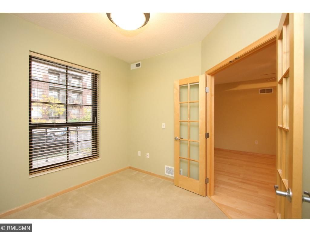 French doors open to den or office space directly off living room