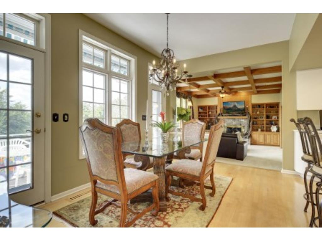 View from the Kitchen to Family Room. Family Room has a Wood Burning Fireplace.