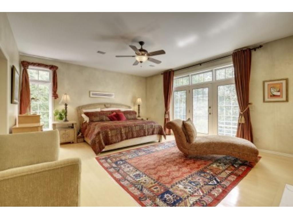 Large Master Bedroom Suite on the Main Level that has a walk out to the Balcony.
