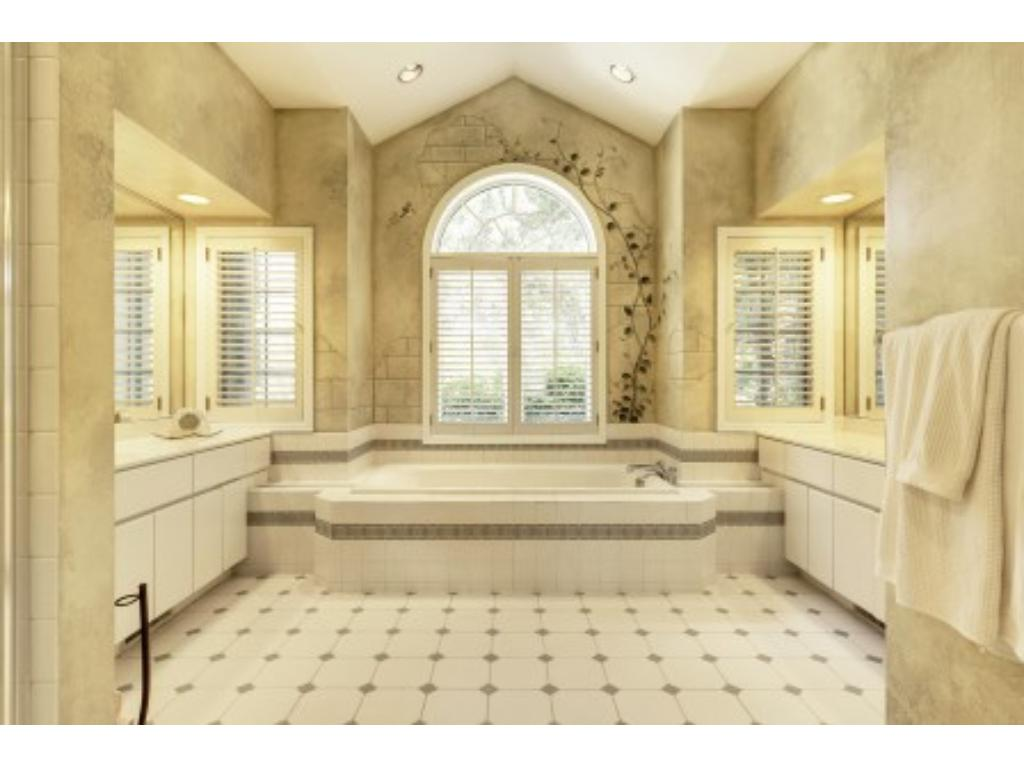 Stunning 14 x 15 Master Bath with Double Sinks, Jacuzzi Tub, Step in Shower and Private Room with Toilet and Bidet.
