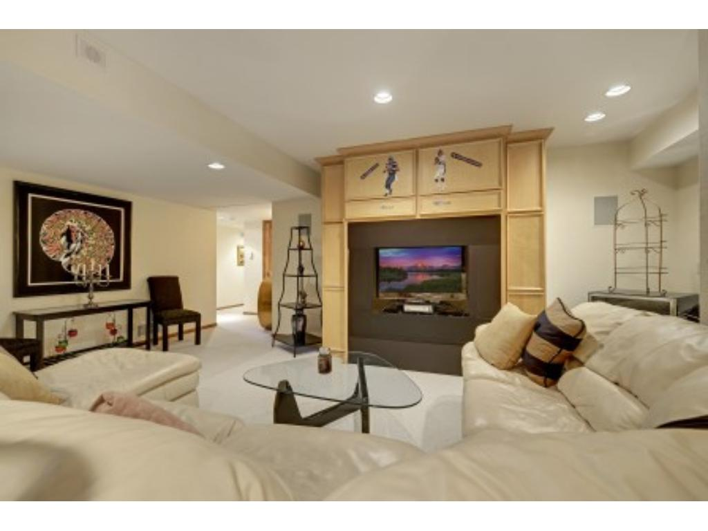 A second Family Room in the Lower Level with Built-in Entertainment Area.