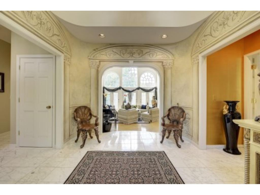 Another view of the dramatic Front Foyer looking into the Living Room.