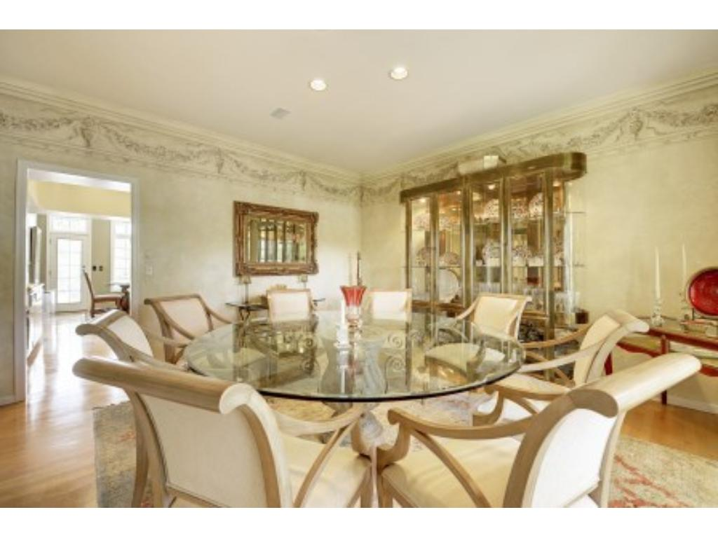 Another view of the Beautiful Dining Room with Crown Moulding and Hardwood Floor.