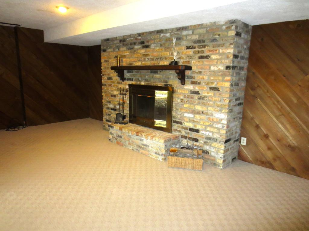 Lower level family room  with a 2 sided fireplace.