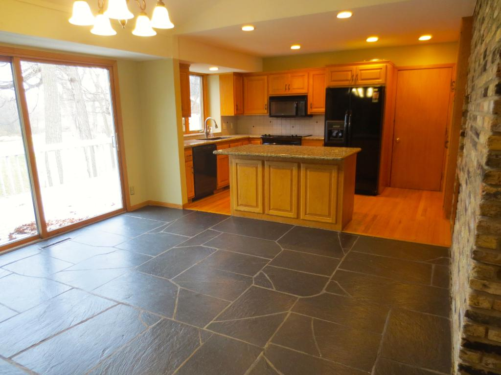 Updated kitchen with granite. Great detail brick wall with an indoor grill.
