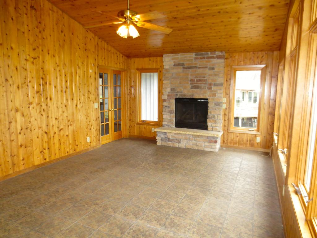 4 season porch with a gas burning fireplace. Doors lead from the dining room and the Master bedroom. Heated tile floors!