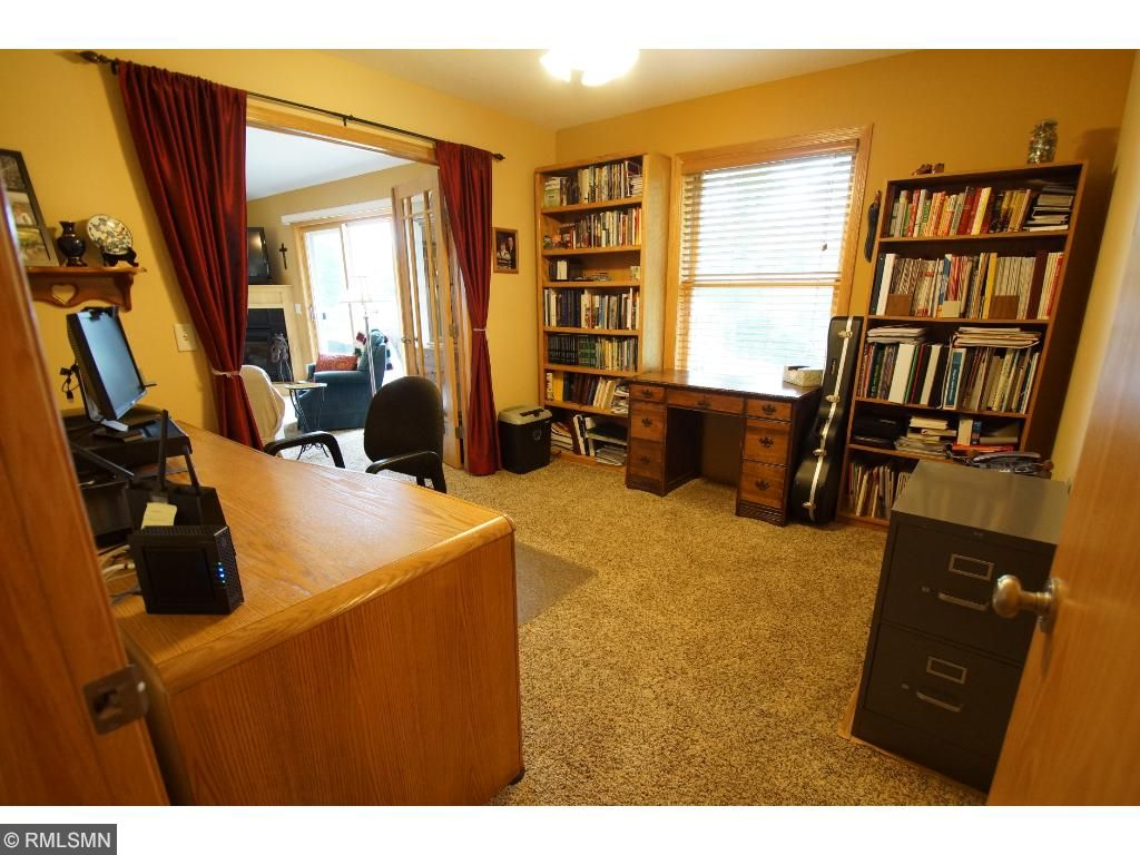 The office/3rd bedroom on the main level has beautiful French doors.
