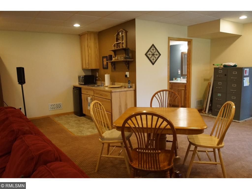 This lower level family room has it all: wet bar/kitchen area, craft area, space for entertaining...