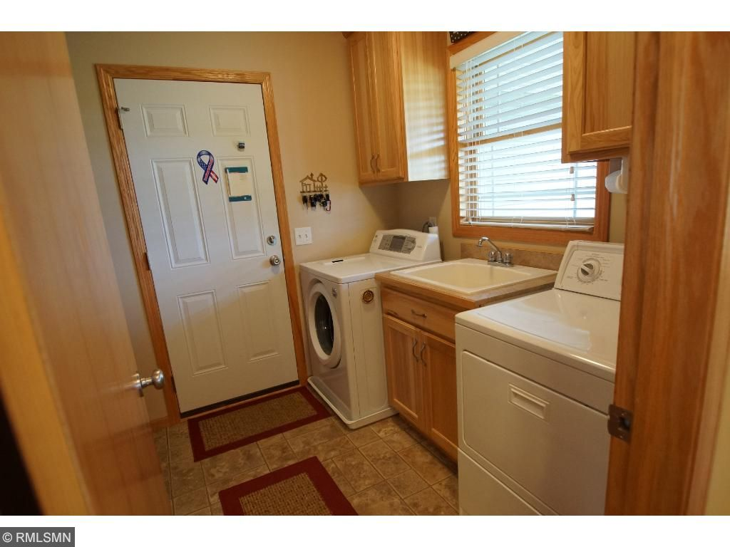 Main level laundry is attached to the garage and has a walk-thru to the full bath. Every feature was considered here!