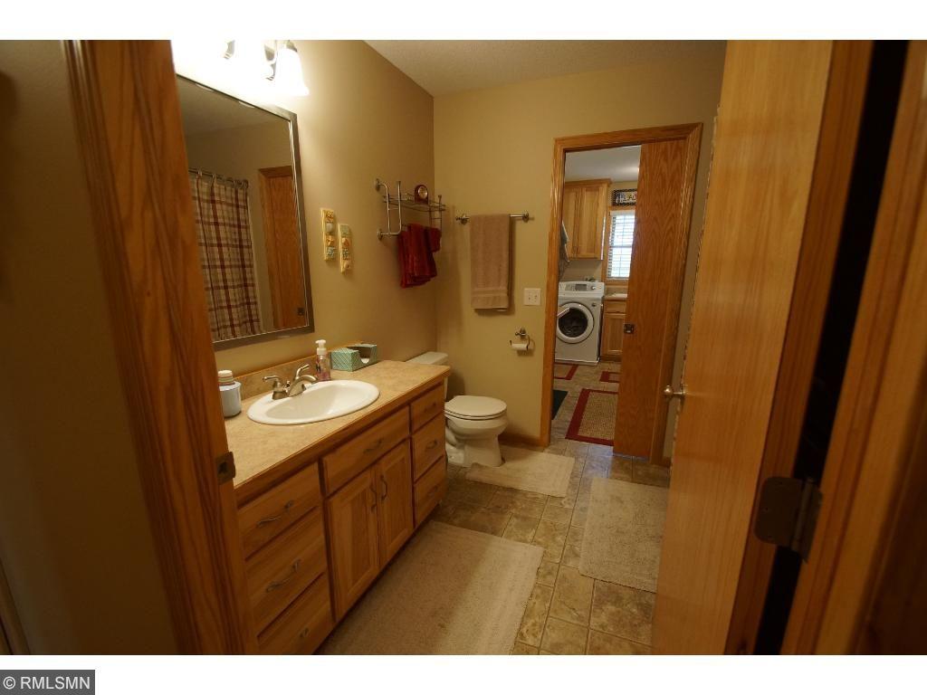 Main floor full bath with walk-thru to laundry and garage.