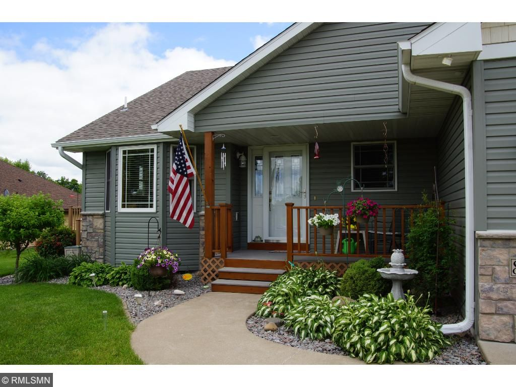 The front porch and lovely landscaping invite you in to this exquisite home!