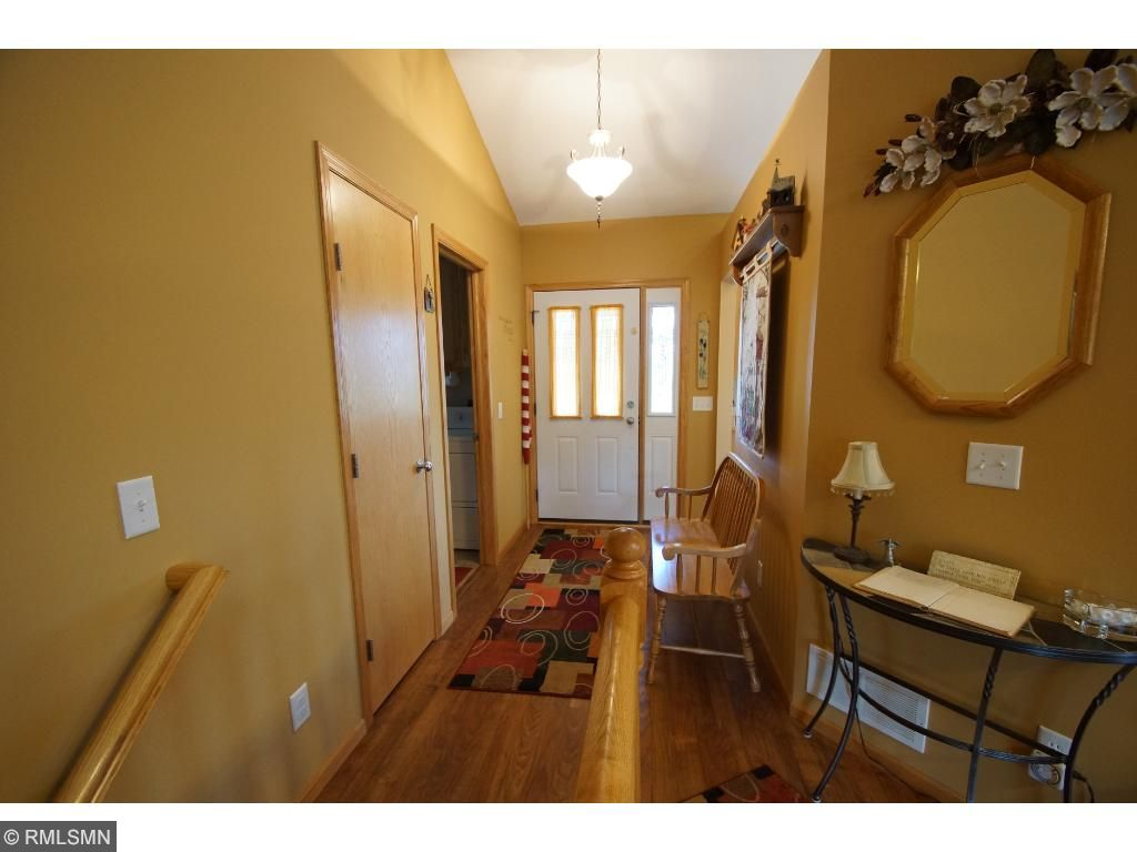 The foyer large, with a coat closet and room for a bench.