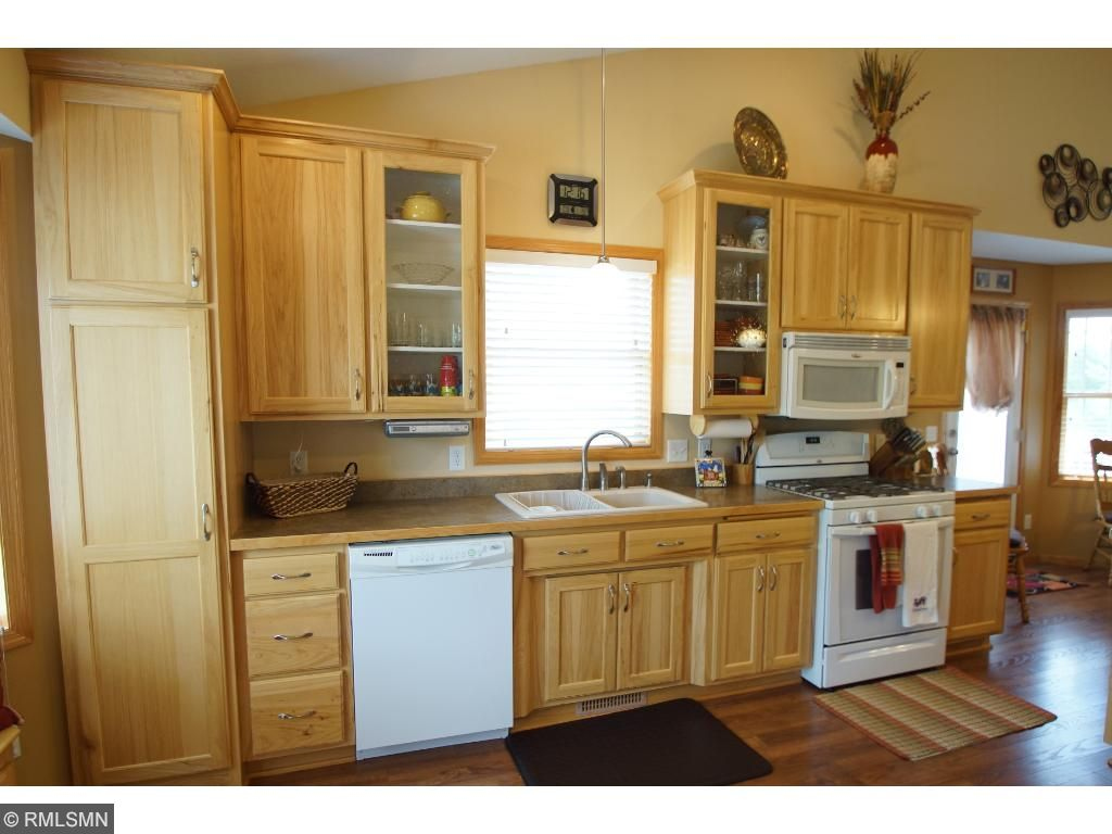 The kitchen has an extra sink, pull-out shelving and lots of lighting.  This is a cook's dream!