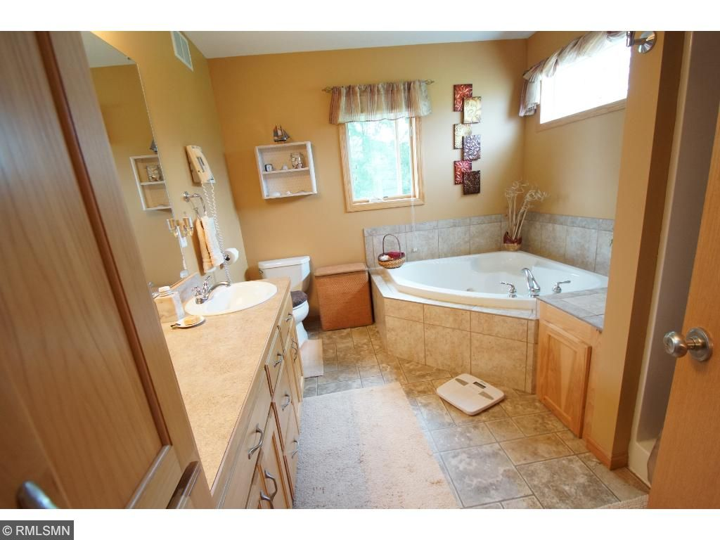 Master bath with both Jacuzzi tub and separate shower.  There is plumbing for a 2nd sink.