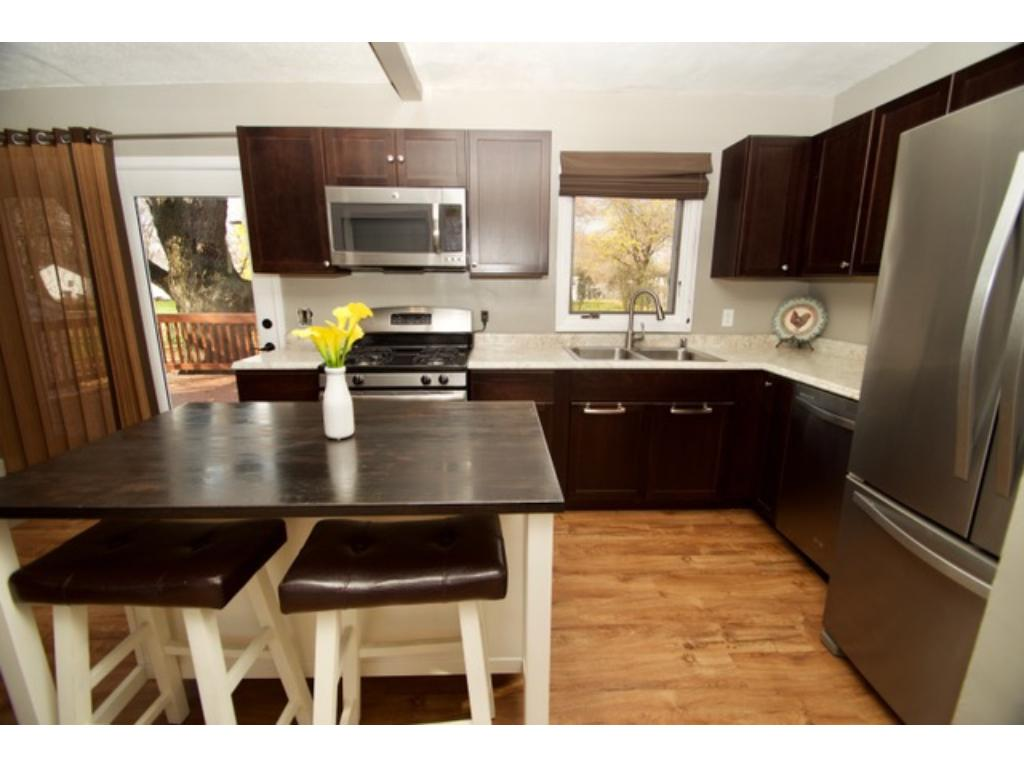 Gorgeous 2016 remodel kitchen offers; New stainless steel appliances, new cabinets and countertops, new flooring, new removable center island with additional seating and storage.  The kitchen also has a pantry and sliding glass door out to the deck.