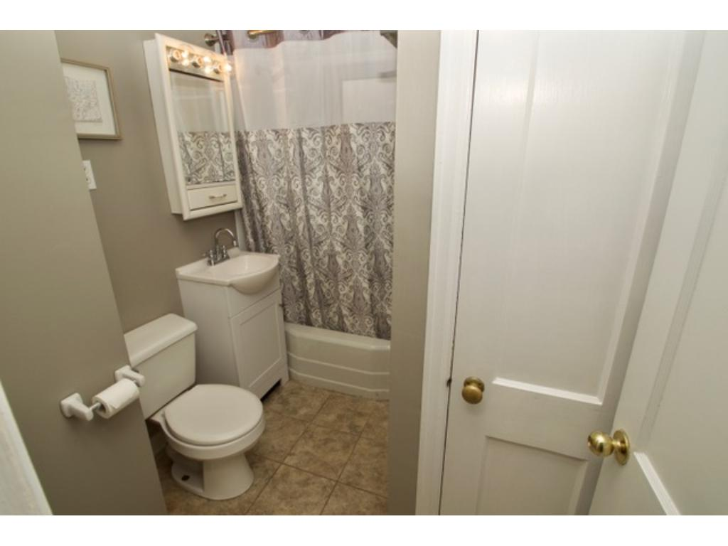 Main full bath with new subway tile, paint and linen closet for your convenience.