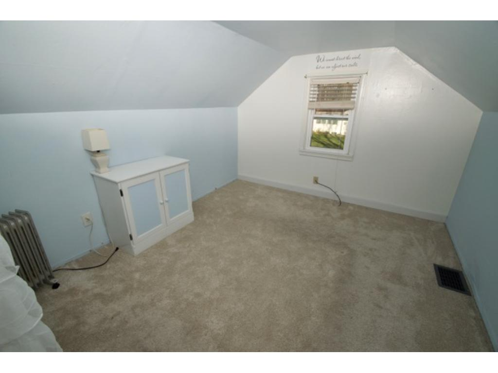 Upper level bedroom with new carpet and nice closet.