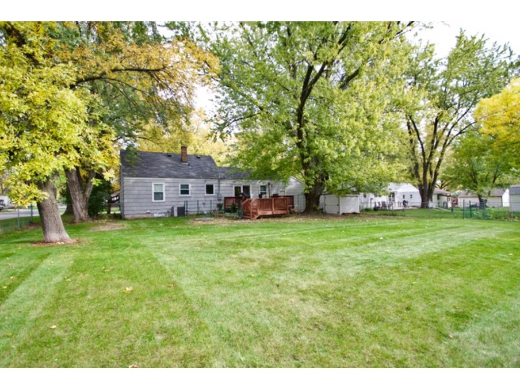 Beautiful and spacious fenced in yard with mature trees.  Enjoy entertaining on the two-tier deck...perfect setup for large gatherings.  Need more space for all your toys?  The shed stays with the home.