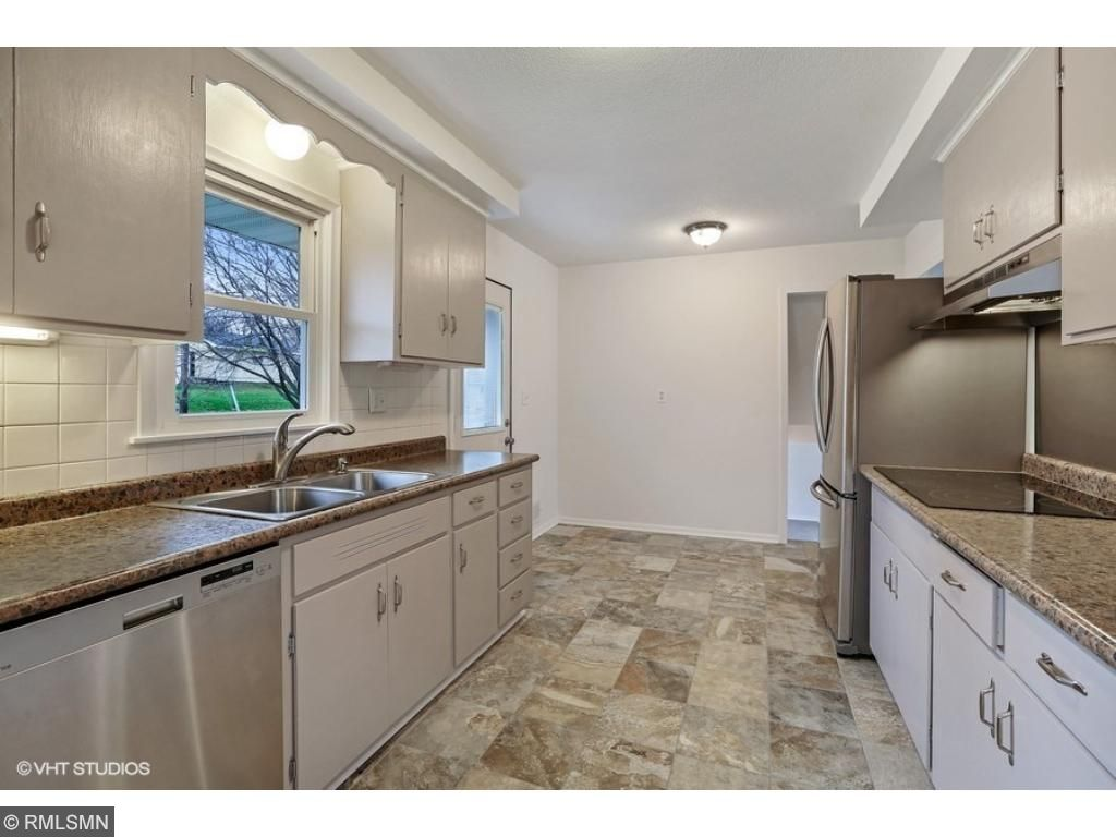 Newer ceramic tile/countertop/sink/faucet. Most appliances are new also!