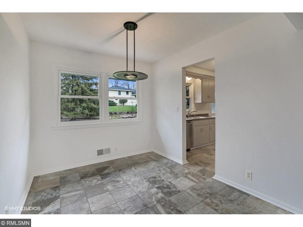 Spacious Dining area with new tile floor!  Great natural light!
