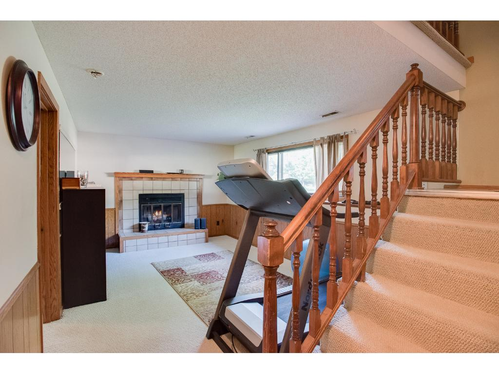 Lower level family room with cozy gas fireplace