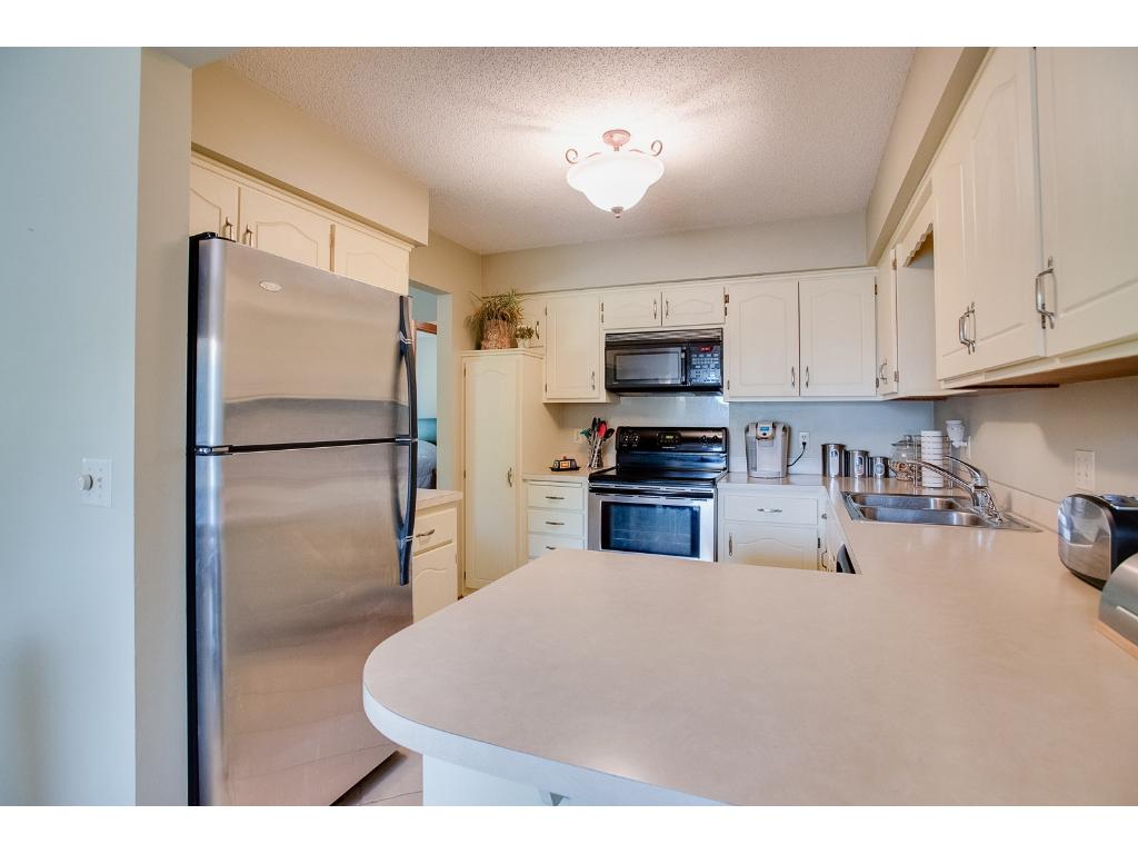 Kitchen featuring ample cabinets, countertops and smart working design you will appreciate