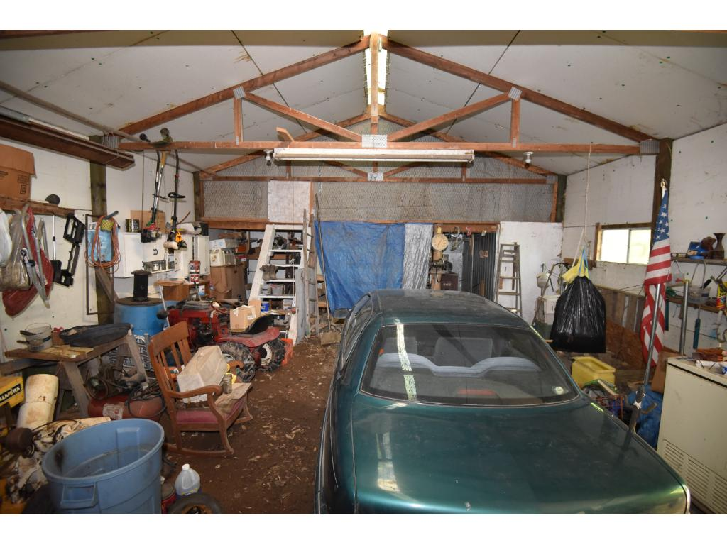 Interior view of insulated garage/shop. Notice gravel floor only.