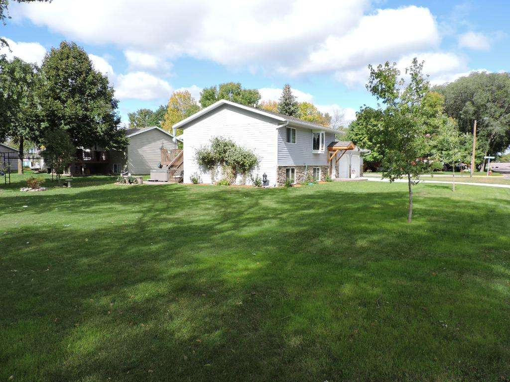 Home is situated on a large, city, corner lot.