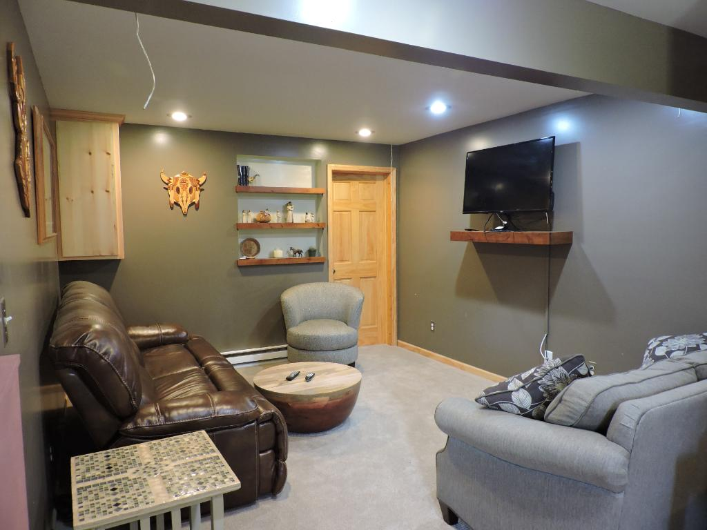 Large L-shaped family room in lower level.