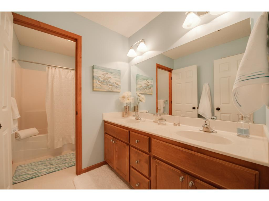 """Smart design with door separating the shower/stool area from the 82"""" double vanity!   Additional linen!"""