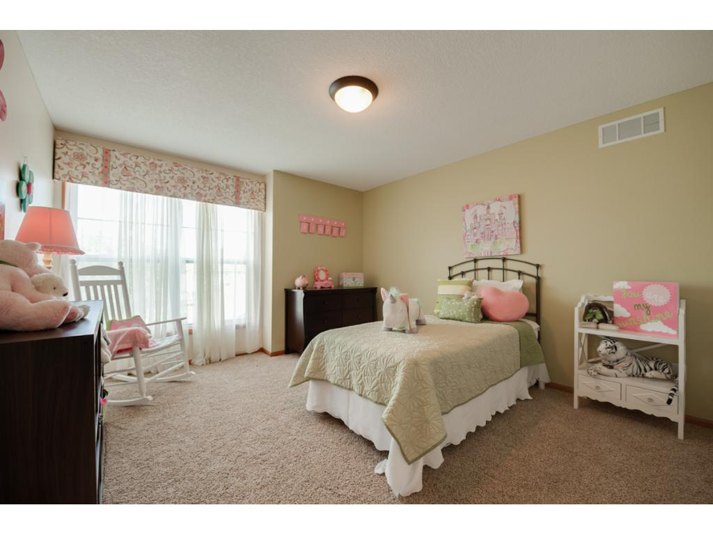 Pretty! One of three additional bedrooms up!