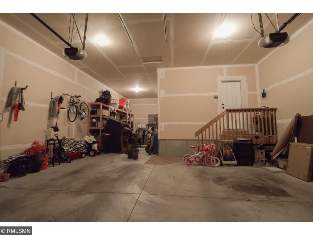Boasting OVERSIZED 3 CAR GARAGE (839 sq. ft.) with spansive 13 foot ceilings! Standard 3 car is 660 Sq ft! WOW!!!