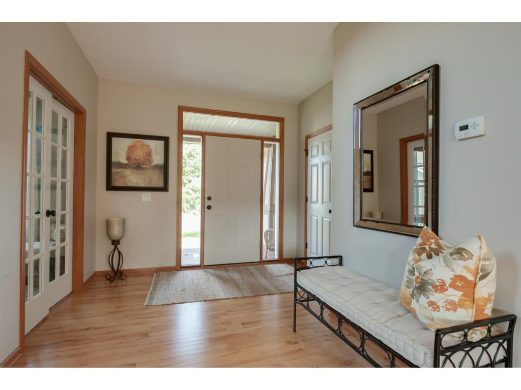 Spacious Foyer with front closet, room for bench and french doors to Office...just lovely!