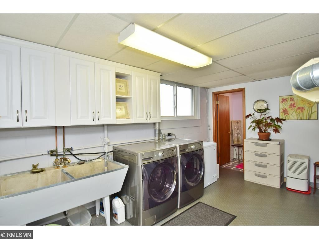 Large laundry room in lower level.