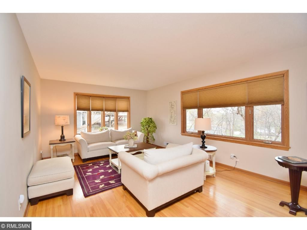 Bright living room features hardwood floors.