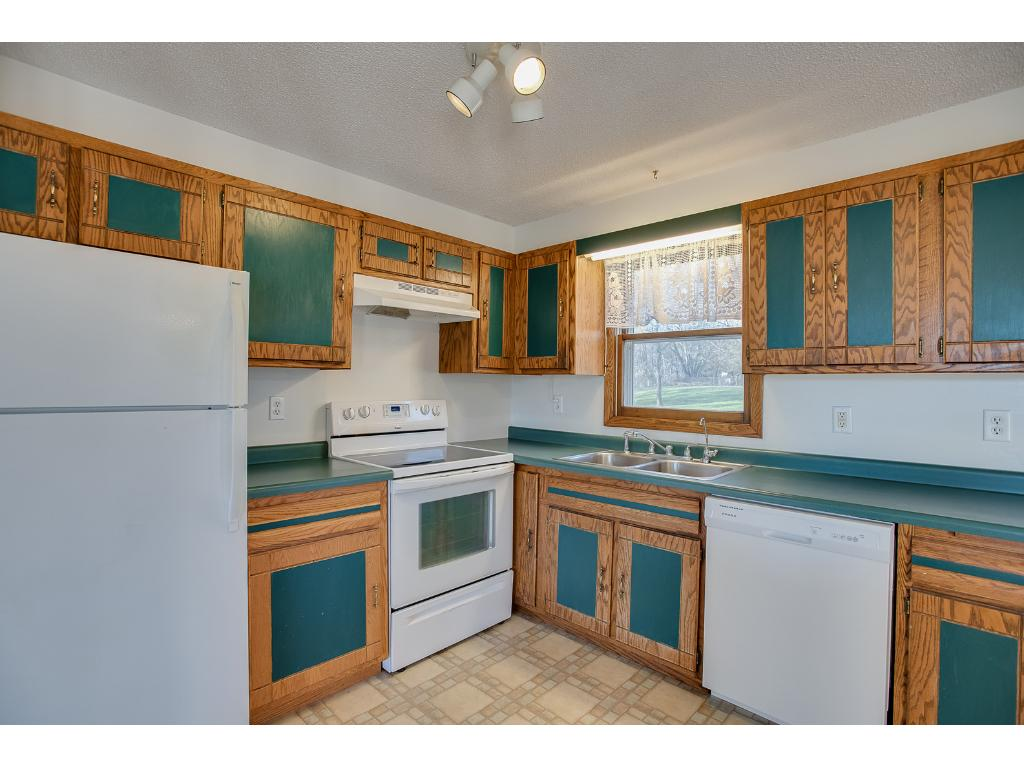 Dishwasher is new and the kitchen features a window overlooking the backyard
