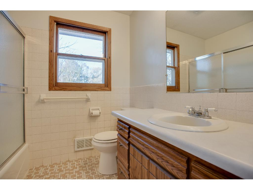 Upper level full bathroom has new tub surround and has neautral decor. Freshly painted throughout the entire home