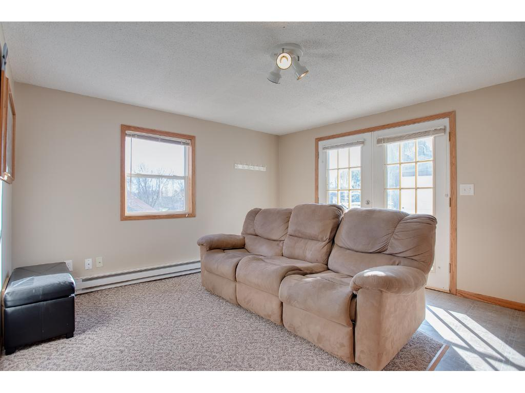 The lower level can easily be converted to feature a family room with a walkout. It is currently set up as a mother in law suite with a kitchen/living and dining room. There is also a full bath and seperate enterance to the lower level.
