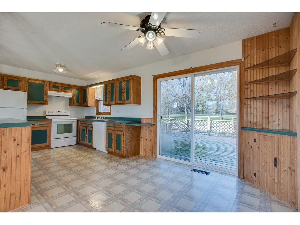 Kitchen has great counter space, is open to the living and dining room and walks out to a huge deck. All appliances in the home will stay.