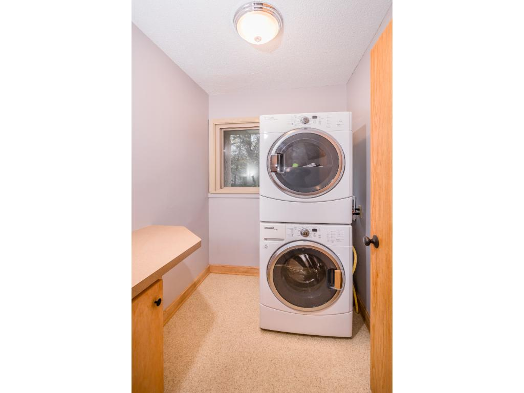 Main floor laundry.  Dryer can also be placed side by side with washer allowing a view of the backyard.