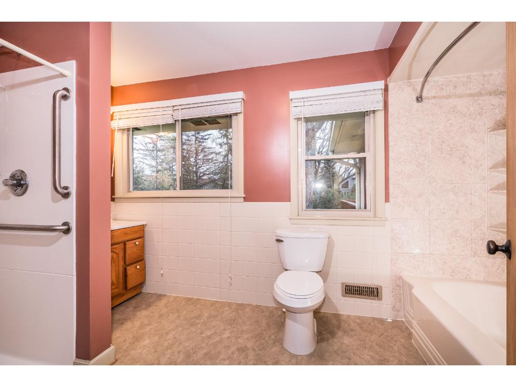 Bathroom features two separate shower spaces! Walk in shower is handicap friendly.