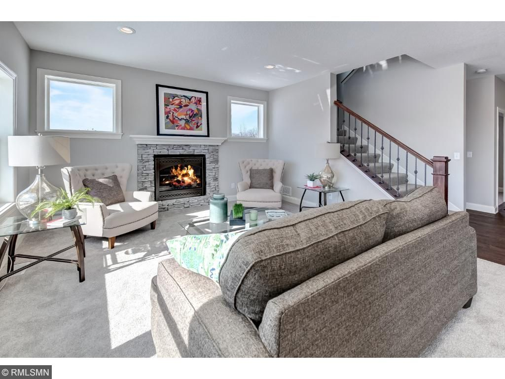 Living Room With Stone Front Gas Fireplace.