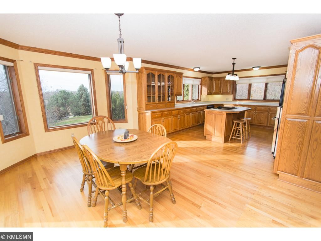 Large kitchen with island & beautiful wood cabinets.