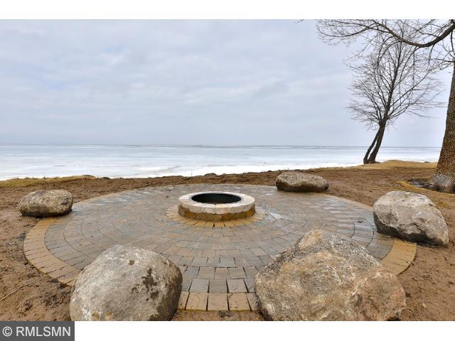 Gather around the lakefront stone fire-pit and sunset views