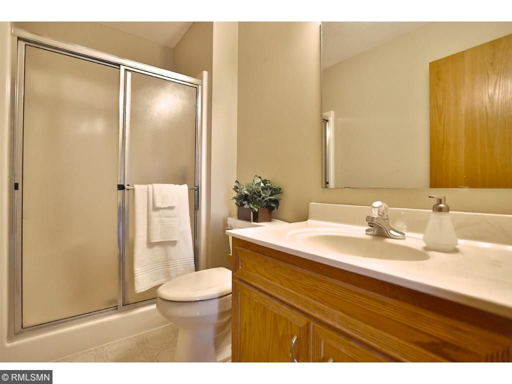 Master bath with walk in shower and extra large vanity.