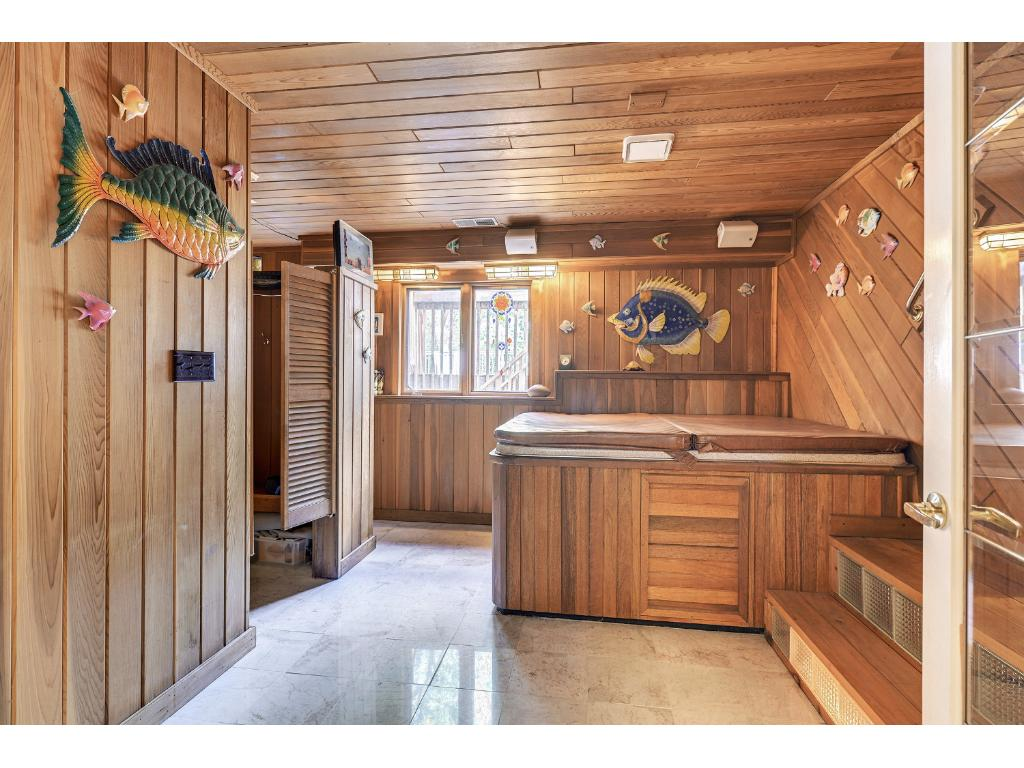 The SPA room has hot tub, sauna and shower.  This amazing room has marble floors and walks out to the pool area.