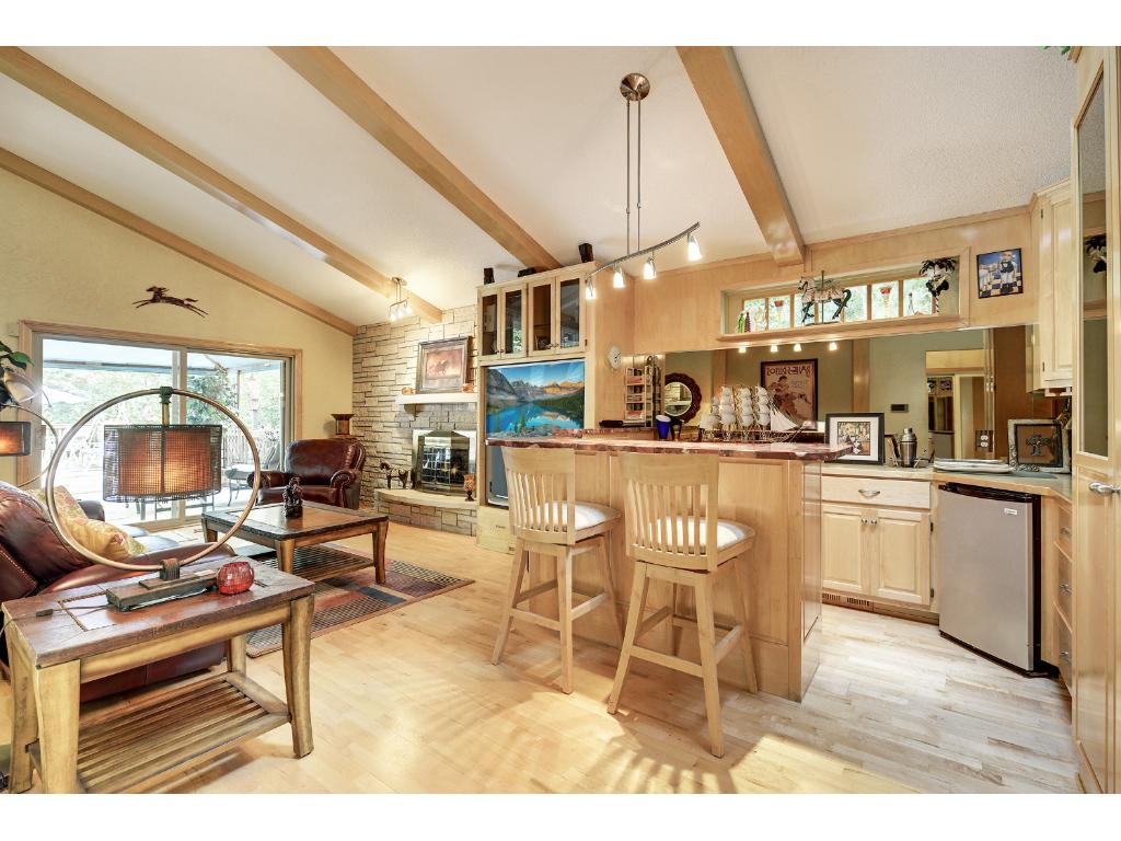 Main level family room off the foyer.  Vaulted Ceilings and hard wood floors.