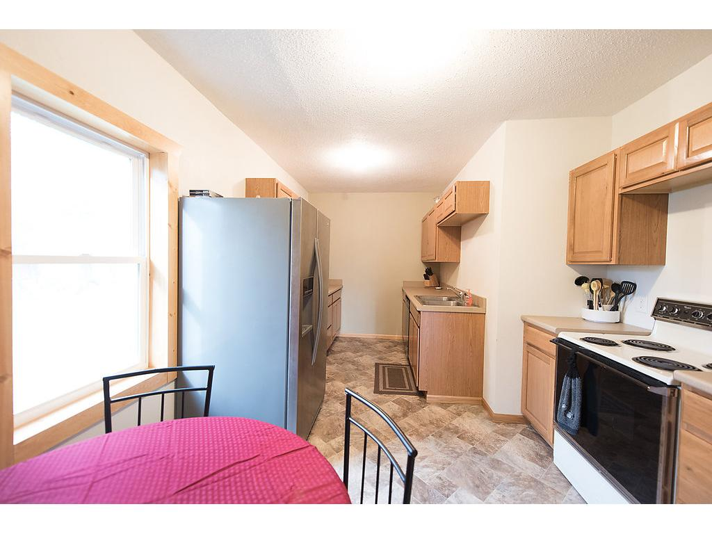 Check out the updated flooring, multiple windows, eat in kitchen and newer paint and trim!