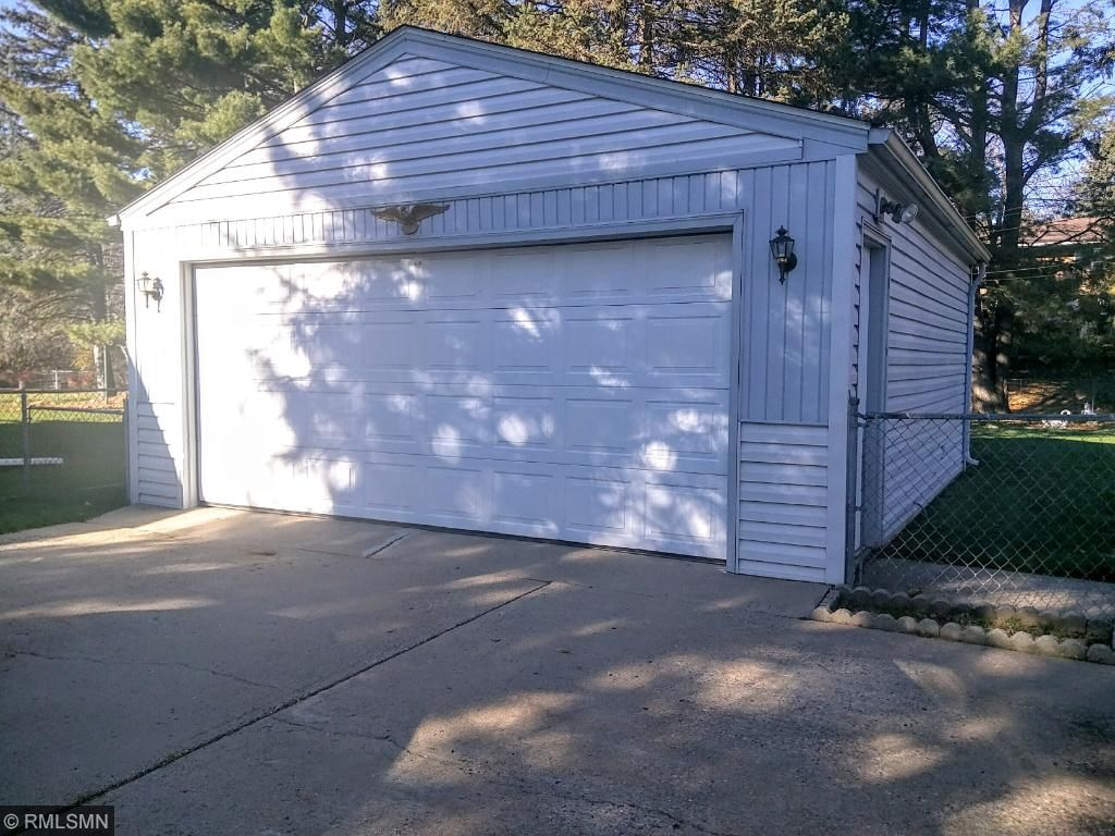Nice full two car garage with newer siding and roofing.