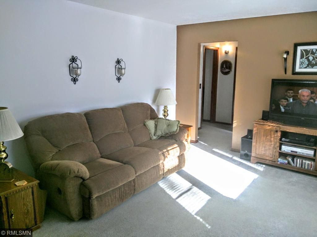 Spacious living room with lots of sunlight.